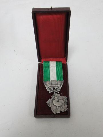 Médaille en bronze , récompense civile ....