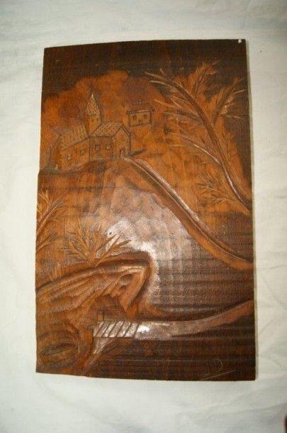 Bas relief en bois figurant un paysage à...