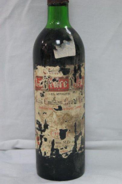 1 bouteille de Saint Emilion Grand Cru, La Grâce de Dieu, Les Menuts, 19??. (étiquette...