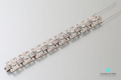 Platinum bracelet, articulated with eight openwork quadrangular motifs featuring...