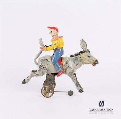 Clown voltigeur sur un âne en tôle peinte,...
