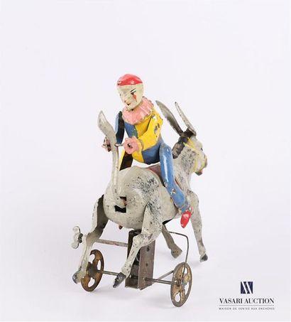Clown voltigeur sur un âne en tôle peinte, mécanisme à clef Marqué O.R.G.M Début...
