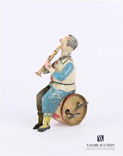 Joueur de hautbois assis sur un tambour en...