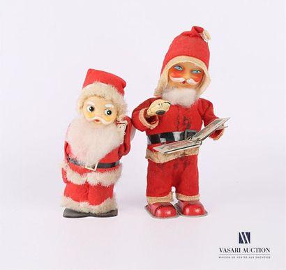 Deux jouets Père Noël en tôle, plastique...