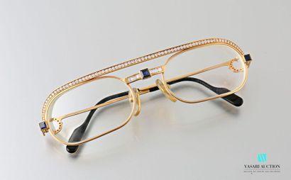 Cartier, paire de lunettes en or jaune 750 millièmes de la collection Must, la branche...