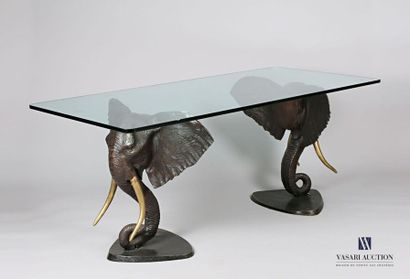 Table, les montants en bronze à patine brune...