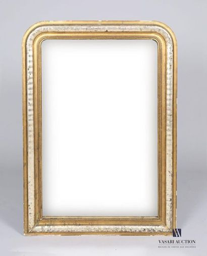 Miroir en bois et stuc mouluré, doré et argenté,...