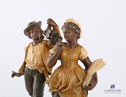 Paire de sujets en régule à patine polychrome représentant une glaneuse et un vigneron...