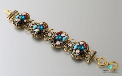 Bracelet orné de quatre médaillons sertis...