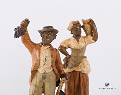 paire de sujets en régule à patine polychrome représentant un vigneron et une laitière....