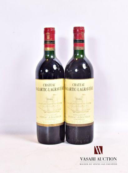 2 bouteillesChâteau MALARTIC LAGRAVIÈREGraves CC 1986  Et. un peu tachées et...