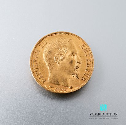 Une pièce en or de 20 francs figurant Napoléon...