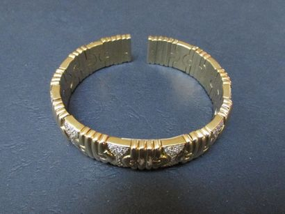 Bracelet godronné semi rigide en or jaune,...