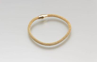 Bracelet de tissu d'argent doré, le fermoir...