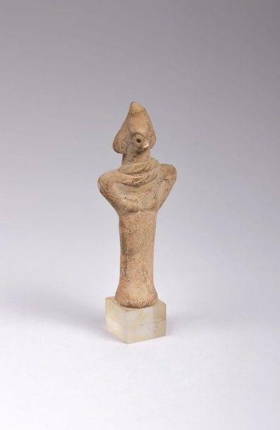 Idole Syro-Hittite en terre cuite beige....