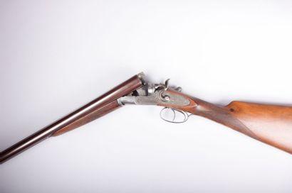 Fusil de chasse à canons juxtaposés  chiens...