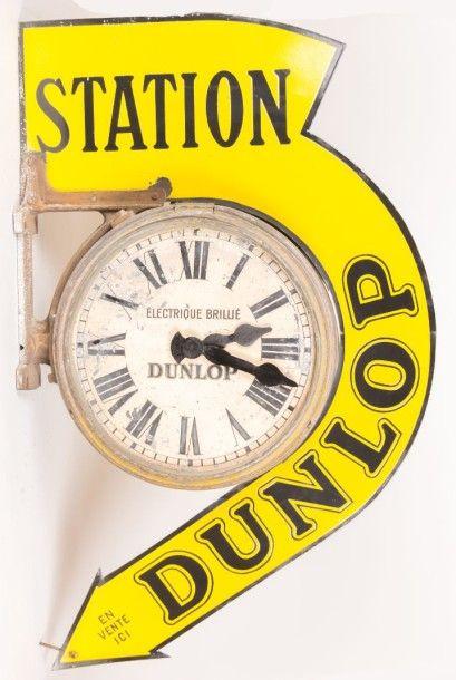 Horloge/Enseigne recto verso composé d'une...