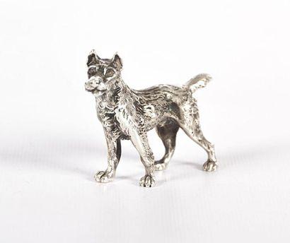 Sujet en argent figurant un chien.  Haut....