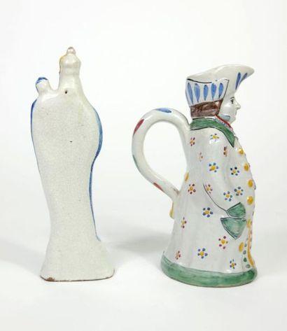 Pichet Jacquot en faïence à décor polychrome au naturel.  Epoque XIXe siècle.  H...