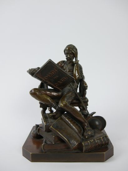 Don Quichotte assis lisant Amadis de Gaule....