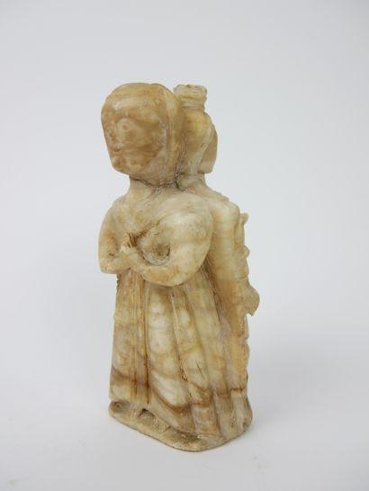 Personnage en albâtre sculpté à deux facettes, représentant une religieuse d'un...