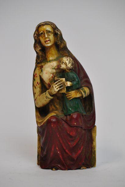 Sculpture en os sculpté et polychrome représentant...