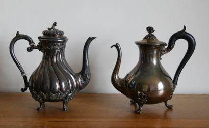 Deux théières en métal argenté et bois noirci....