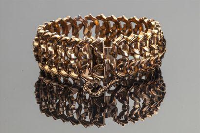 Bracelet articulé à mailles en or jaune 18k...