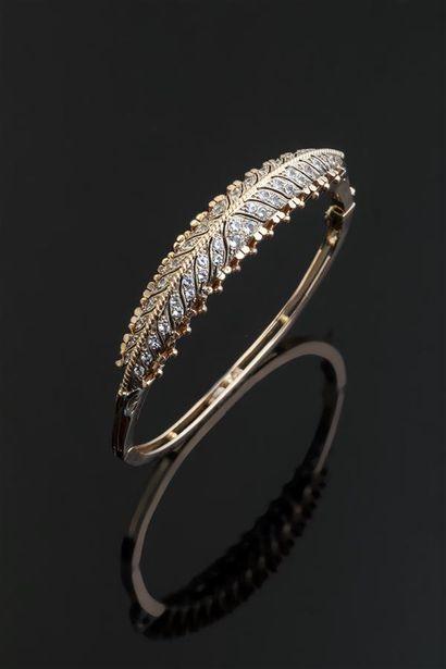 Bracelet rigide ouvrant en or (750/1000e)...