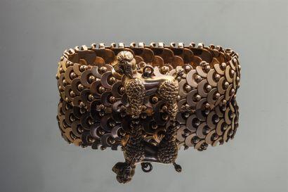 Bracelet souple en or jaune 18k (750/1000e)...