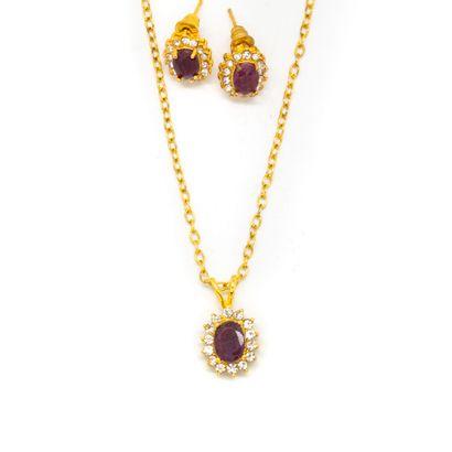 Parure en métal doré comprenant un collier...