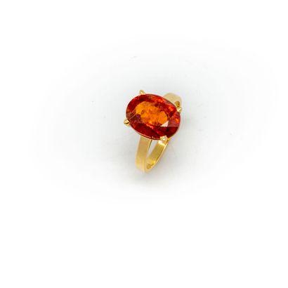 18k yellow gold ring set with a mandarin spessartite garnet weighing approximately...