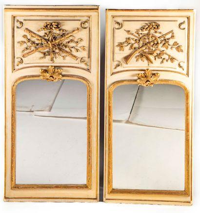 Deux trumeaux en bois peint et doré à décor...