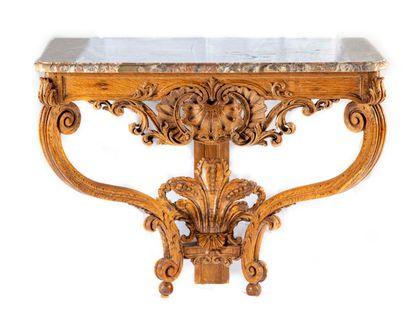 Console en chêne mouluré et sculpté à décor...
