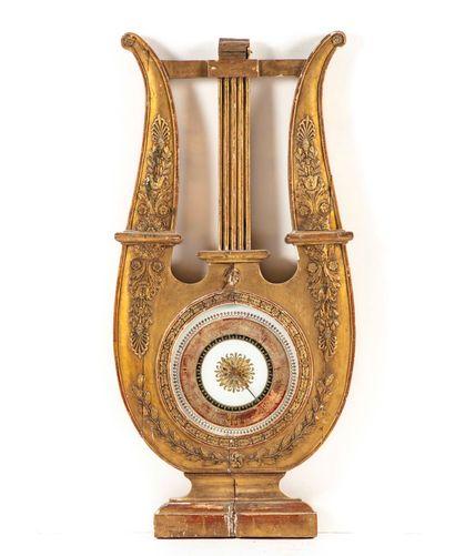 Baromètre en forme de lyre en bois doré et...