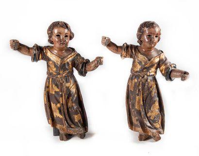 Paire de sculptures d'anges (porte flambeaux)...