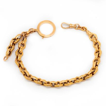 Chaine de montre en or jaune  Poids : 16...