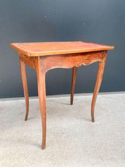 Table de milieu en bois naturel ouvrant par...