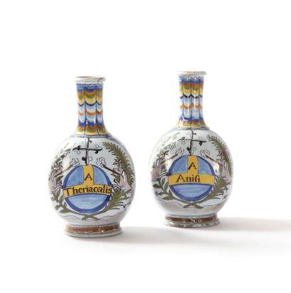Nevers  Deux bouteilles en faïence à décor polychrome à la palette sur une face...