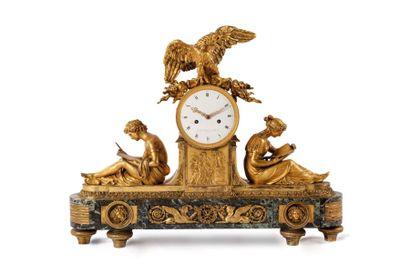 Pendule à l'Etude en bronze doré, la Lecture et l'Ecriture adossées au cadran surmonté...
