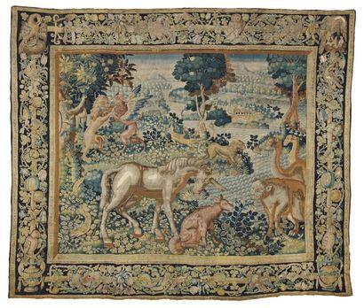 Bruxelles, XVIème siècle Tapisserie en laine et soie. Importante verdure à animaux...