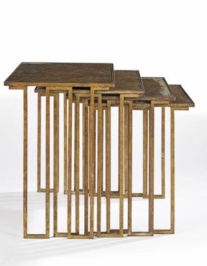 Jean ROYERE (1902-1981)  Tables gigognes à quatre éléments en fer doré de section...