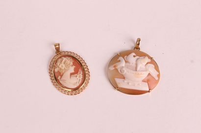 TWO PENDANTS, each one decorated with a cameo...