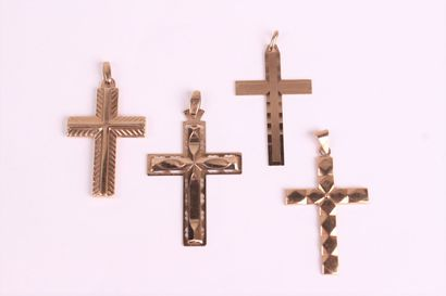 SET of four cross pendants in yellow gold...
