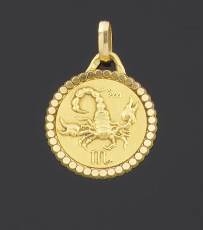 MEDAL of round form in yellow gold 750 thousandths...