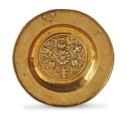 OFFER PLATE in repoussé brass decorated with pomegranates, cherubs and a daisy on...