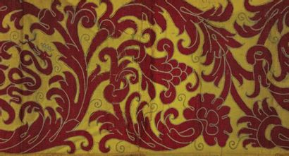 Yellow and red silk band embroidered with foliage and flowers scrolls surrounding...