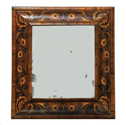 Mirror in olive veneer and inlaid with boxwood and ebony decorated with foliage...
