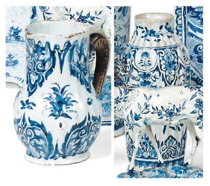 PETIT VASE en faïence blanc bleu à décor de fleurs. XVIIIe siècle. On y joint un...