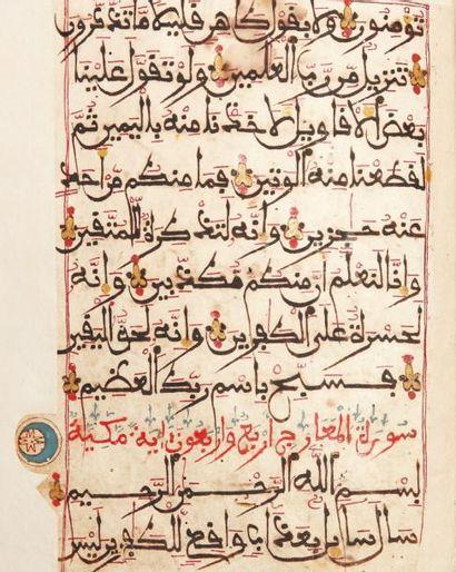 Feuillets de Coran Quatorze folios en deux cahiers, en écriture maghribî à l'encre...